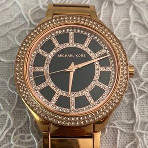 Gold and black Michael Kors watch with crystals